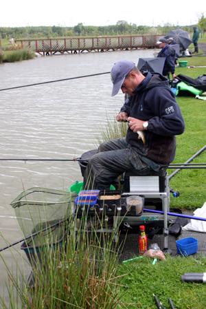 Wardle unhooks a small carp